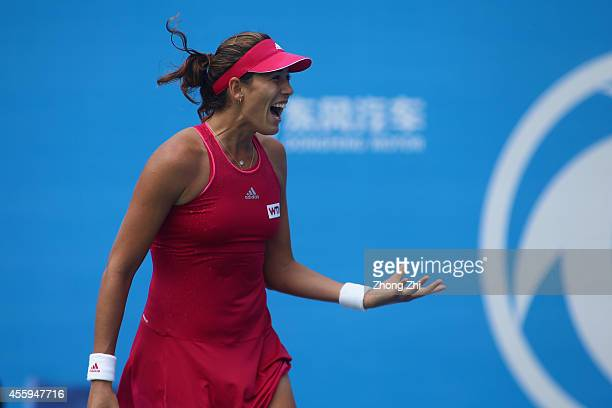 Garbine Muguruza of Spain celebrates after won her match against Simona Halep of Romania during day three of the 2014 Dongfeng Motor Wuhan Open at...