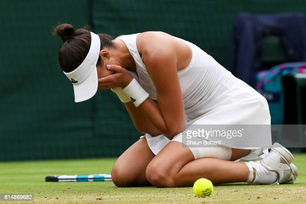 Garbine Muguruza of Spain celebrates championship point and victory after the Ladies Singles final against Venus Williams of The United States on day...