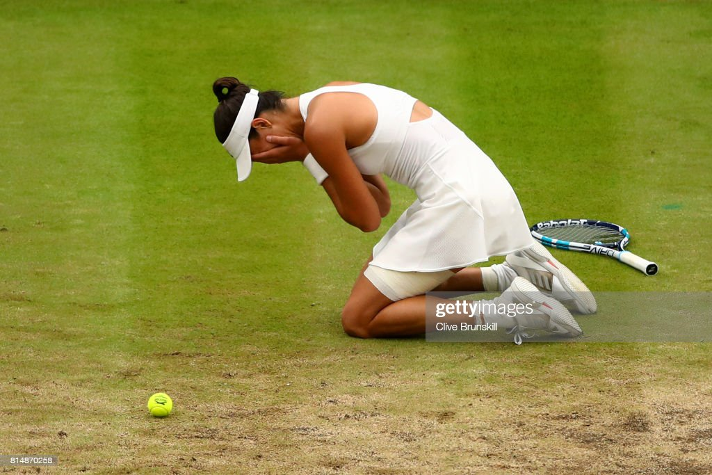 Garbine Muguruza of Spain celebrates championship point and victory after the Ladies Singles final against Venus Williams of The United States on day twelve of the Wimbledon Lawn Tennis Championships at the All England Lawn Tennis and Croquet Club at Wimbledon on July 15, 2017 in London, England.
