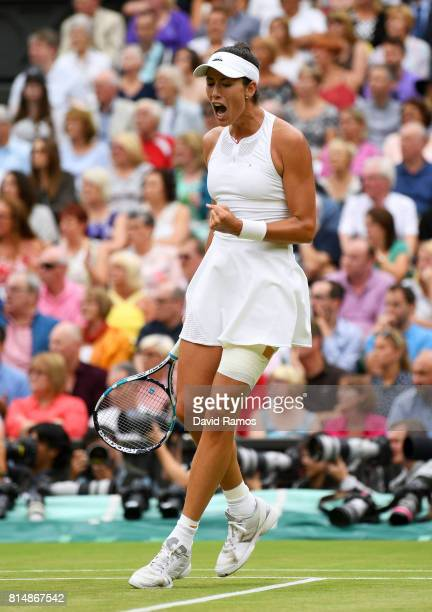 Garbine Muguruza of Spain celebrates during the Ladies Singles final against Venus Williams of The United States on day twelve of the Wimbledon Lawn...