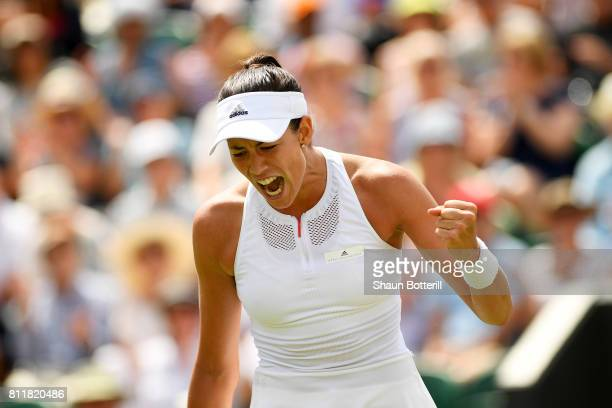 Garbine Muguruza of Spain celebrates during the Ladies Singles fourth round match against Angelique Kerber of Germany on day seven of the Wimbledon...
