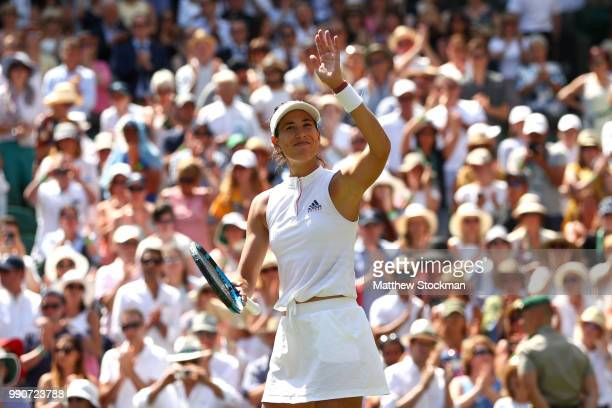Garbine Muguruza of Spain celebrates her victory over Naomi Broady of Great Britain after their Ladies' Singles first round match on day two of the...