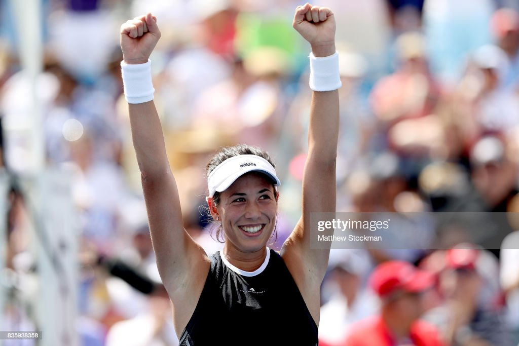 Garbine Muguruza of Spain celebrates her win over Simona Halep of Romania during the women's final on day 9 of the Western & Southern Open at the Lindner Family Tennis Center on August 20, 2017 in Mason, Ohio.