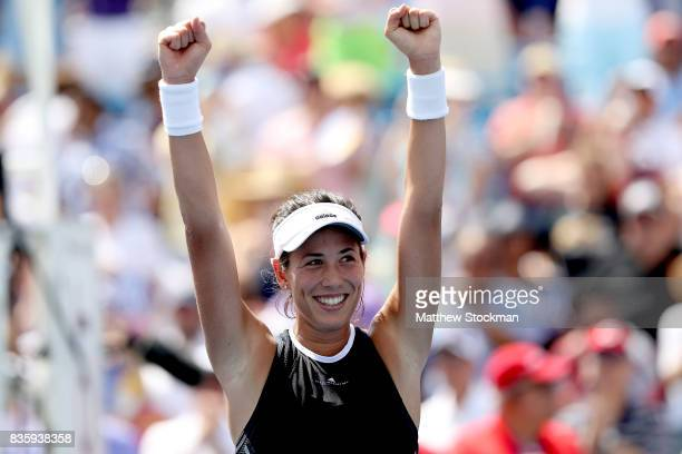 Garbine Muguruza of Spain celebrates her win over Simona Halep of Romania during the women's final on day 9 of the Western Southern Open at the...