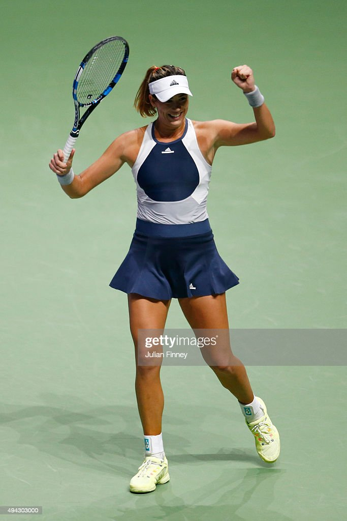 Garbine Muguruza of Spain celebrates match point against Lucie Safarova of Czech Republic to a round robin match during the BNP Paribas WTA Finals at Singapore Sports Hub on October 26, 2015 in Singapore.
