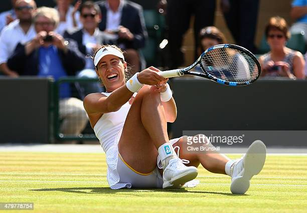 Garbine Muguruza of Spain celebrates match point in her Ladies Singles Quarter Final match against Timea Bacsinszky of Switzerland during day eight...