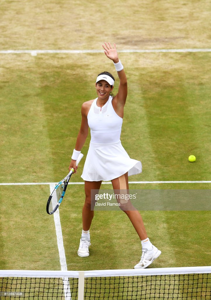 Garbine Muguruza of Spain celebrates victory after the Ladies Singles quarter final match against Svetlana Kuznetsova of Russia on day eight of the Wimbledon Lawn Tennis Championships at the All England Lawn Tennis and Croquet Club on July 11, 2017 in London, England.