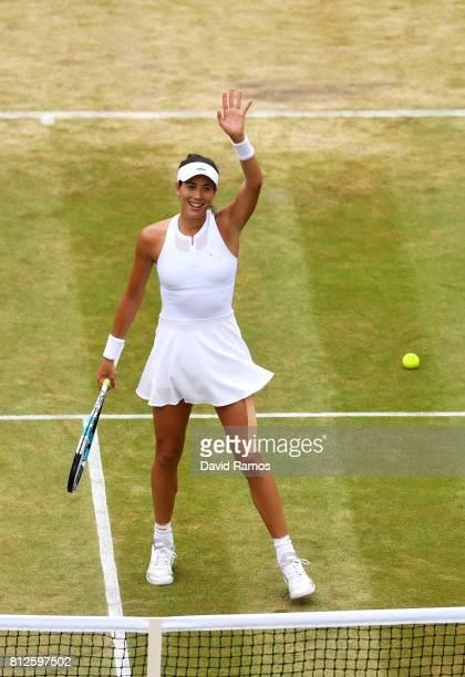 Garbine Muguruza of Spain celebrates victory after the Ladies Singles quarter final match against Svetlana Kuznetsova of Russia on day eight of the...