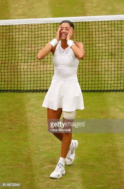 Garbine Muguruza of Spain celebrates victory after the Ladies Singles final against Venus Williams of The United States on day twelve of the...