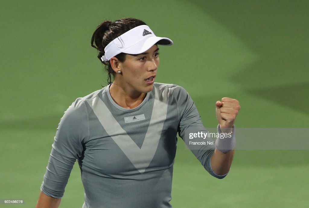 Garbine Muguruza of Spain celebrates victory against Catherine Bellis of USA during day three of the WTA Dubai Duty Free Tennis Championship at the Dubai Tennis Stadiumon February 21, 2018 in Dubai, United Arab Emirates.