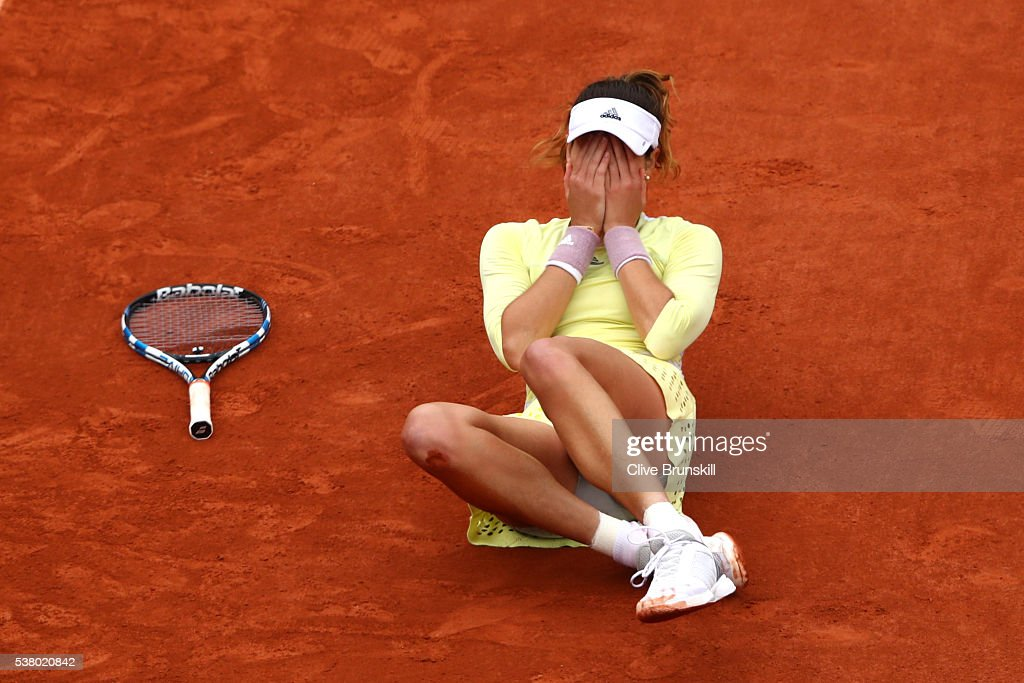 Garbine Muguruza of Spain celebrates victory during the Ladies Singles final match against Serena Williams of the United States on day fourteen of the 2016 French Open at Roland Garros on June 4, 2016 in Paris, France.
