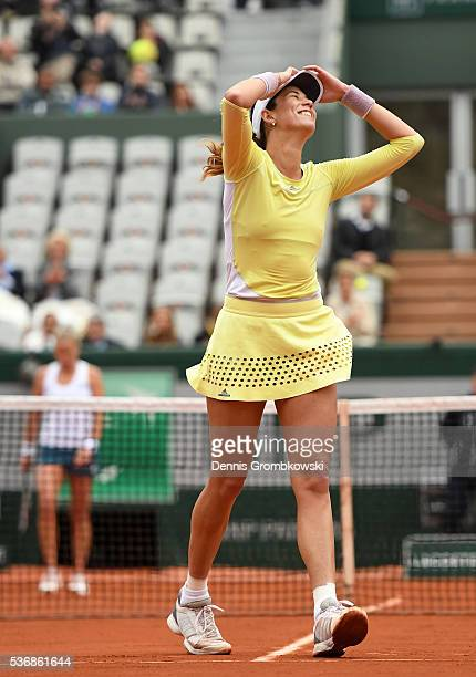 Garbine Muguruza of Spain celebrates victory during the Ladies Singles quarter final against Shelby Rogers of the United States on day eleven of the...