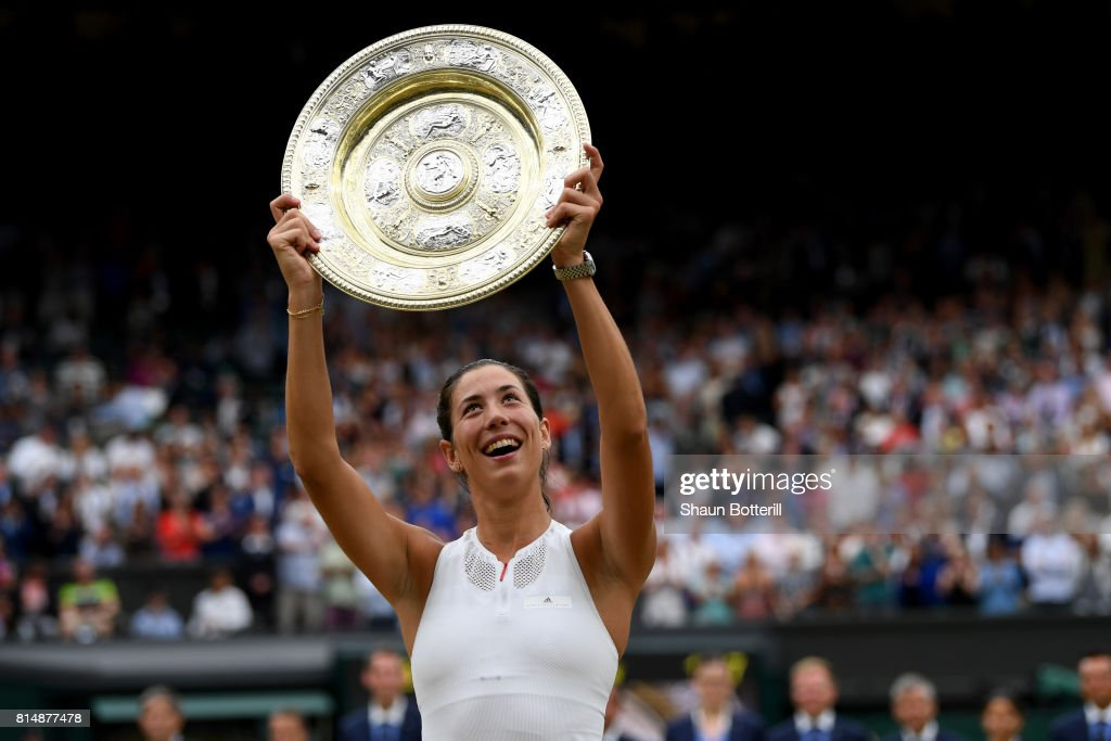Garbine Muguruza of Spain celebrates victory with the trophy after the Ladies Singles final against Venus Williams of The United States on day twelve of the Wimbledon Lawn Tennis Championships at the All England Lawn Tennis and Croquet Club at Wimbledon on July 15, 2017 in London, England.