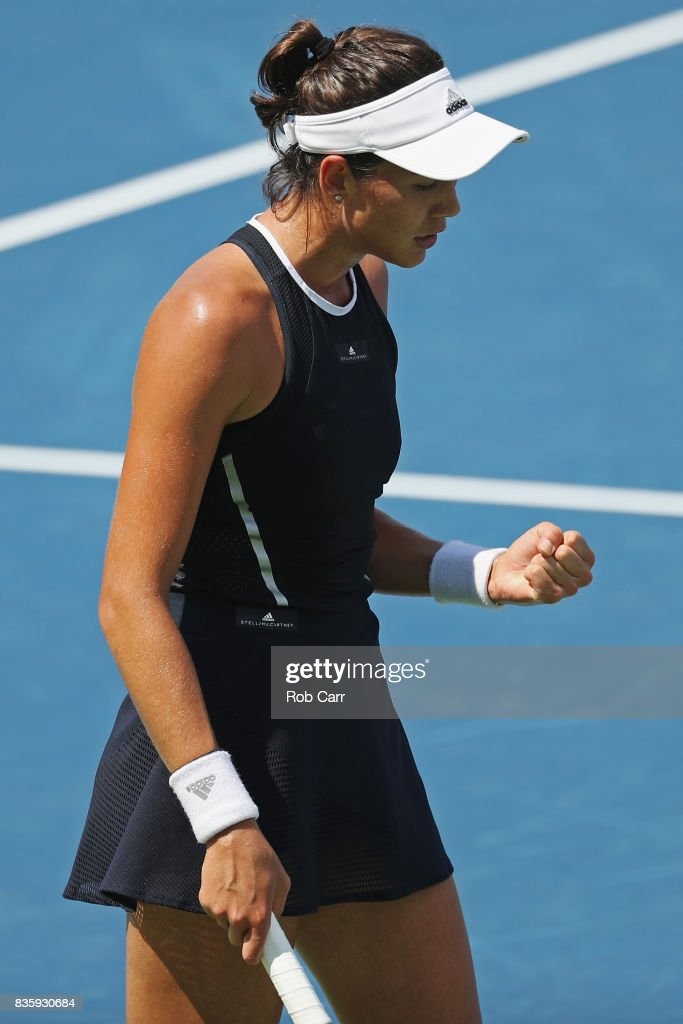 Garbine Muguruza of Spain celebrates winning a point against Simona Halep of Romania during Day 9 of the women's final of the Western and Southern Open at the Linder Family Tennis Center on August 20, 2017 in Mason, Ohio.