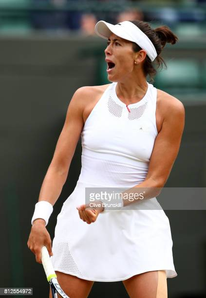 Garbine Muguruza of Spain celebrates winning the first set during the Ladies Singles quarter final match against Svetlana Kuznetsova of Russia on day...