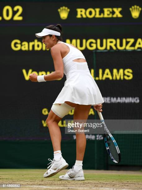 Garbine Muguruza of Spain celebrates winning the first set during the Ladies Singles final against Venus Williams of The United States on day twelve...