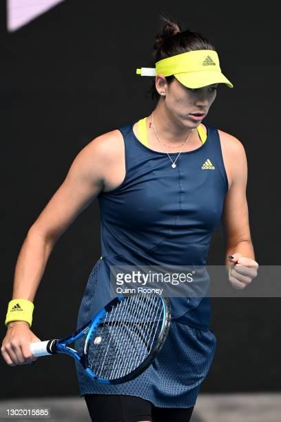 Garbine Muguruza of Spain celebrates winning the first set in her Women's Singles fourth round match against Naomi Osaka of Japan during day seven of...