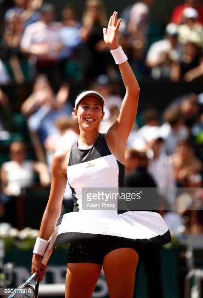 Garbine Muguruza of Spain celebrates winning the second round match against Anett Kontaveit of Estonia on day four of the 2017 French Open at Roland...