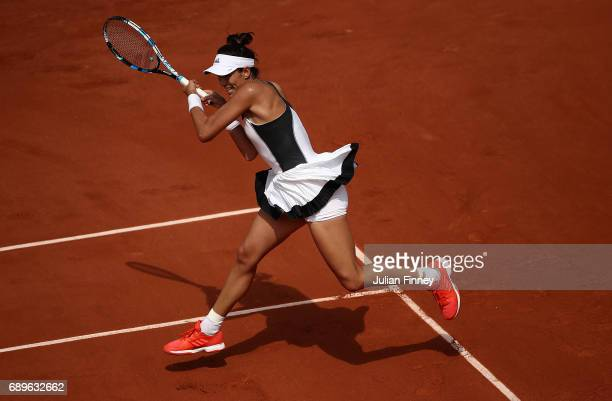 Garbine Muguruza of Spain hits a backhand during the first round match against Francesca Schiavone of Italy on day two of the 2017 French Open at...