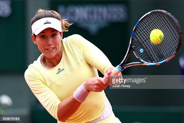 Garbine Muguruza of Spain hits a backhand during the Ladies Singles first round match against Anna Karolina Schmiedlova of Slovakia on day two of the...
