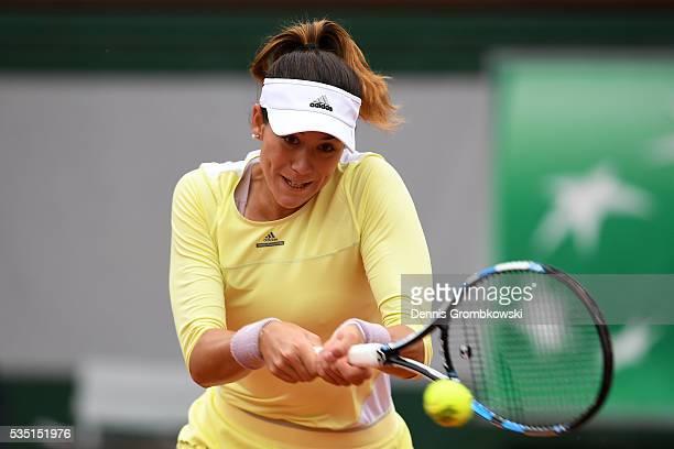 Garbine Muguruza of Spain hits a backhand during the Ladies Singles fourth round match against Svetlana Kuznetsova of Russia on day eight of the 2016...