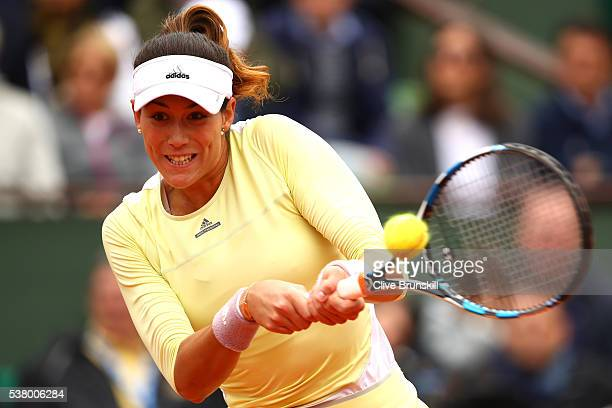 Garbine Muguruza of Spain hits a backhand during the Ladies Singles final match against Serena Williams of the United States on day fourteen of the...
