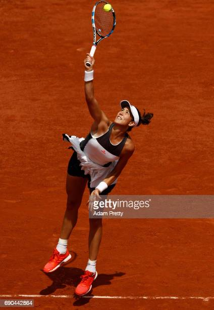 Garbine Muguruza of Spain hits a backhand during the second round match against Anett Kontaveit of Estonia on day four of the 2017 French Open at...