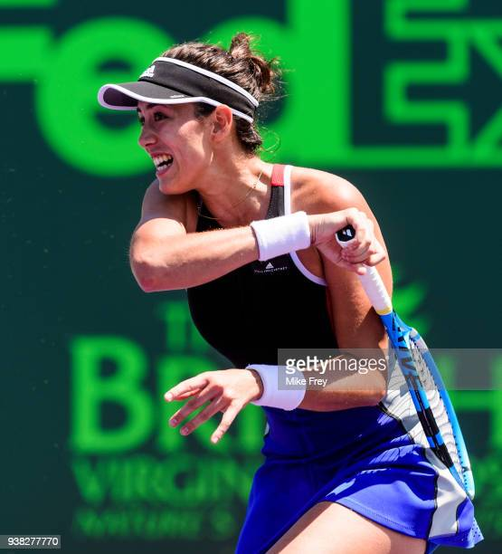 Garbine Muguruza of Spain hits a forehand against Sloane Stephens of the USA during Day 8 of the Miami Open Presented by Itau at Crandon Park Tennis...