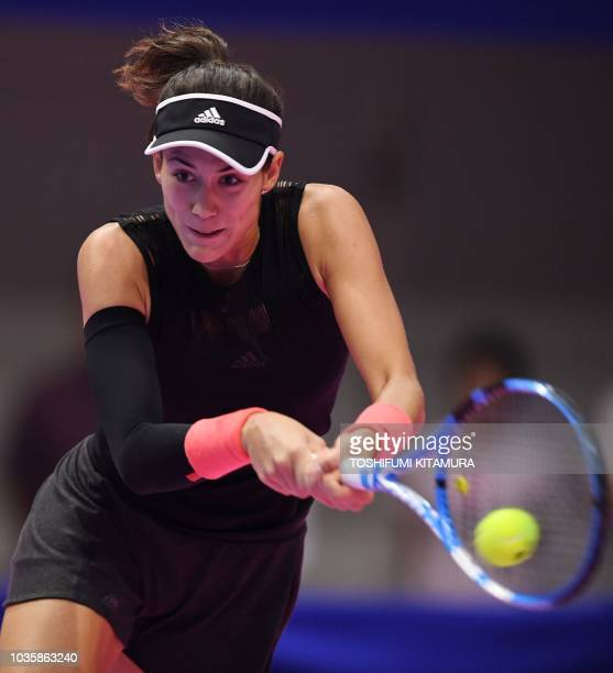 Garbine Muguruza of Spain hits a return against Alison Riske of the US during their women's singles second round tennis match at the Pan Pacific Open...