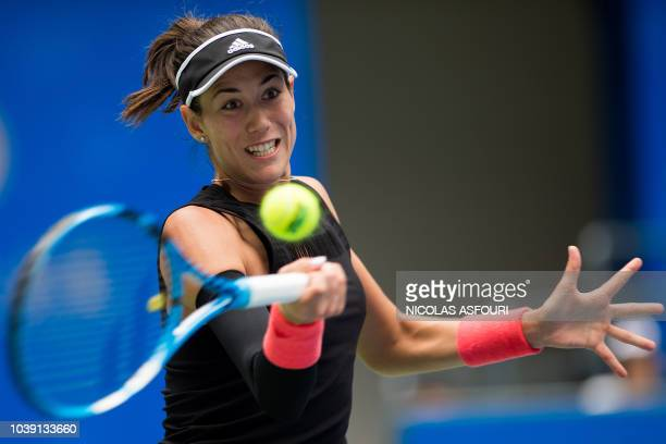Garbine Muguruza of Spain hits a return against Alison Van Uytvanck of Belgium during their women's singles second round match of the WTA Wuhan Open...
