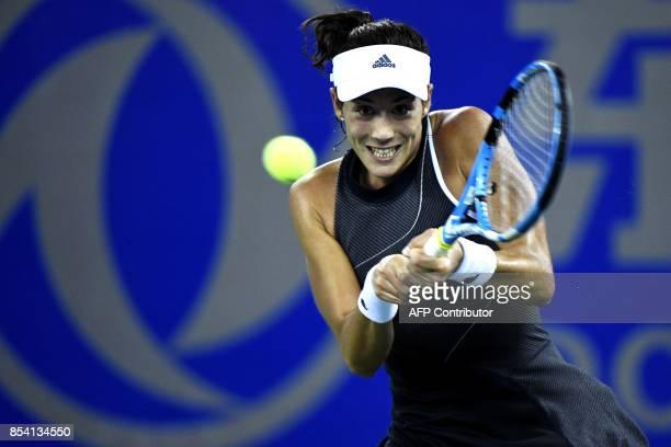 Garbine Muguruza of Spain hits a return against Lesia Tsurenko of Ukraine during their second round women's singles match at the WTA Wuhan Open...