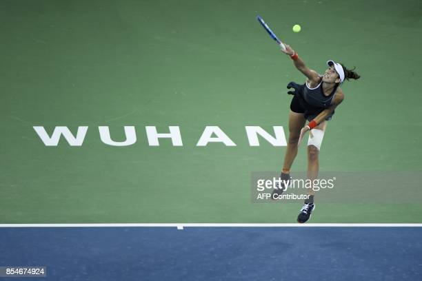 Garbine Muguruza of Spain hits a return against Magda Linette of Poland during their third round women's singles match at the WTA Wuhan Open tennis...
