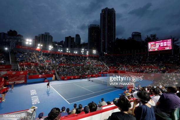 Garbine Muguruza of Spain hits a return during her women's singles semifinal match against Wang Qiang of China at the Hong Kong Open tennis...