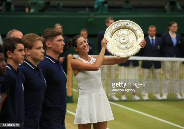 Garbine Muguruza of Spain hold the winner's trophy after beating Venus Williams of USA in the Women's Final of the 2017 Wimbledon Championships at...