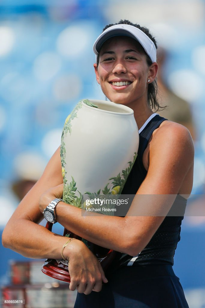 Garbine Muguruza of Spain holds up the trophy after defeating Simona Halep of Romania to win the women's final of the Western and Southern Open at the Linder Family Tennis Center on August 20, 2017 in Mason, Ohio.