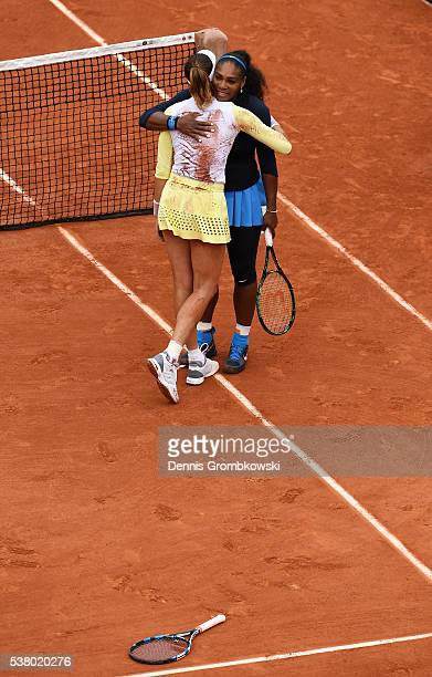 Garbine Muguruza of Spain hugs Serena Williams of the United States following her victory during the Ladies Singles final match on day fourteen of...
