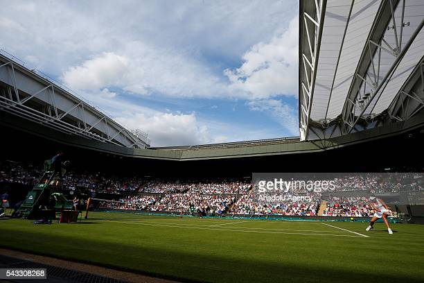 Garbine Muguruza of Spain in action against Camilla Giorgi of Italy in the womens' singles on day one of the 2016 Wimbledon Championships at the All...