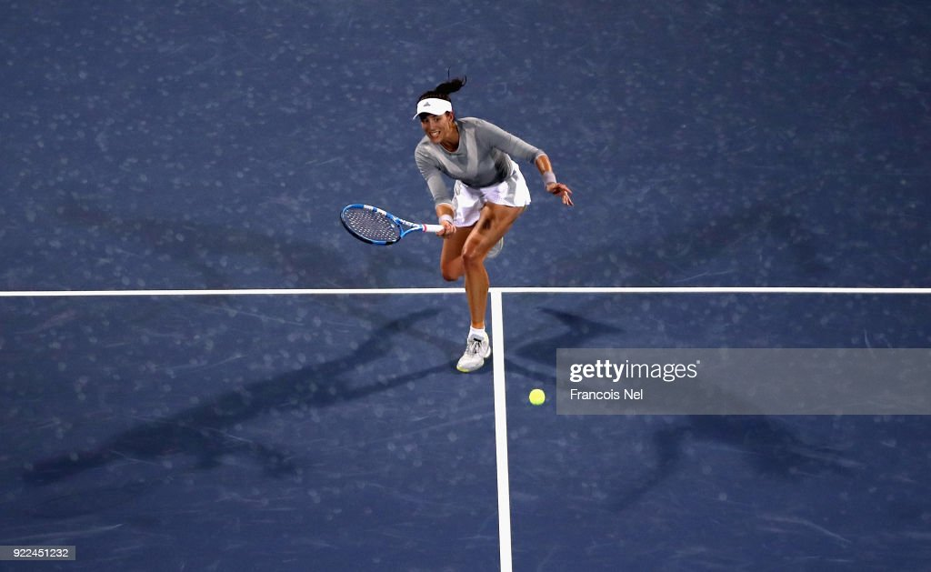 Garbine Muguruza of Spain in action against Catherine Bellis of USA during day three of the WTA Dubai Duty Free Tennis Championship at the Dubai Tennis Stadiumon February 21, 2018 in Dubai, United Arab Emirates.