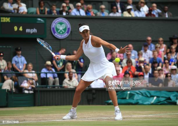 Garbine Muguruza of Spain in action against Magdalena Rybarikova of Slovakia during the women's semifinal on day ten of the 2017 Wimbledon...