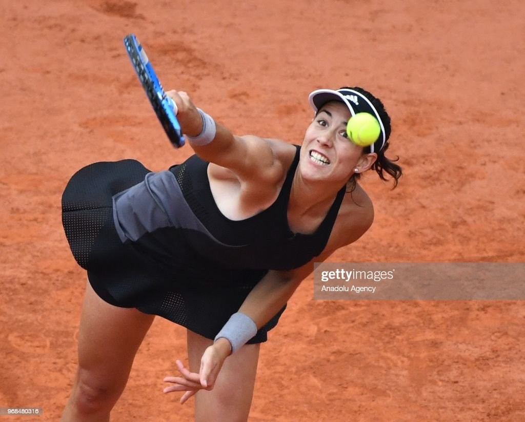 Garbine Muguruza of Spain in action against Maria Sharapova (not seen) of Russia during their quarter final match at the French Open tennis tournament at Roland Garros Stadium in Paris, France on June 06, 2018.