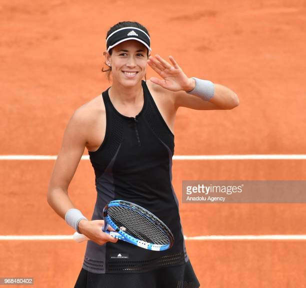 Garbine Muguruza of Spain in action against Maria Sharapova of Russia during their quarter final match at the French Open tennis tournament at Roland...