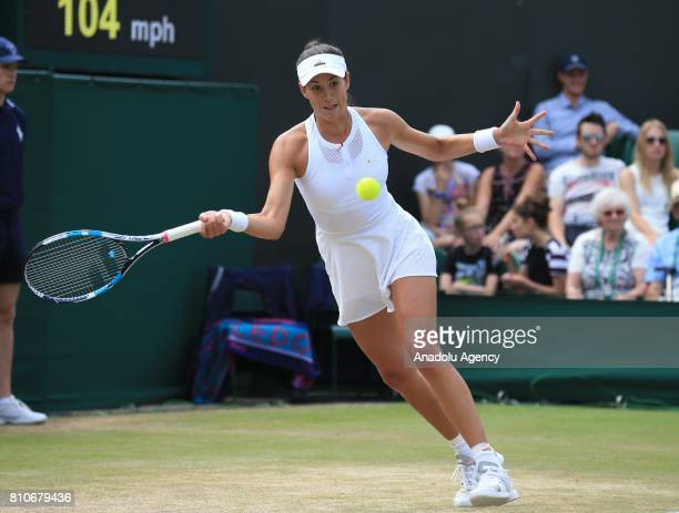 Garbine Muguruza of Spain in action against Sorana Cirstea of Romania on day six of the 2017 Wimbledon Championships at the All England Lawn and...