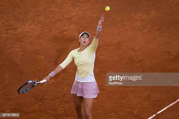 Garbine Muguruza of Spain in action IrinaCamelia Begu of Romania their match during day three of the Mutua Madrid Open tennis tournament at the Caja...