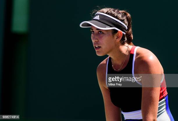 Garbine Muguruza of Spain looks on after losing a point against Sloane Stephens of the USA during Day 8 of the Miami Open Presented by Itau at...
