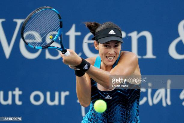 Garbine Muguruza of Spain plays a backhand during her match against Cori Gauff during Western & Southern Open - Day 4 at Lindner Family Tennis Center...