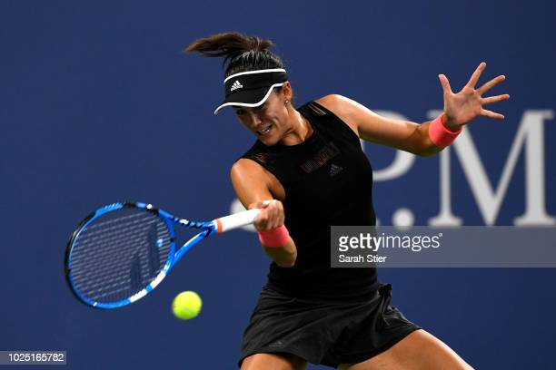 Garbine Muguruza of Spain plays a backhand during her women's singles second round match against Karolina Muchova of Czech Republic on Day Three of...