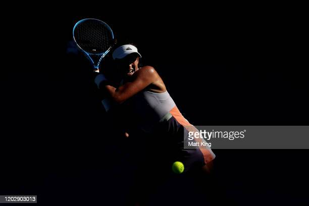 Garbine Muguruza of Spain plays a backhand during her Women's Singles Semifinal match against Simona Halep of Romania on day eleven of the 2020...