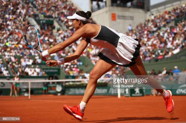 Garbine Muguruza of Spain plays a backhand during the ladies singles fourth round match against Kristina Mladenovic of France on day eight of the...