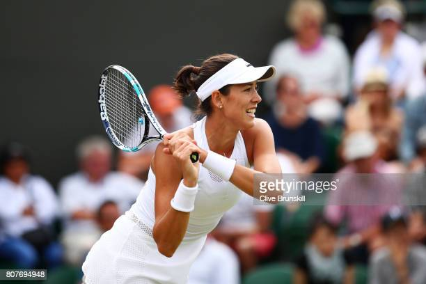 Garbine Muguruza of Spain plays a backhand during the Ladies Singles first round match against Ekaterina Alexandrova of Russia day two of the...