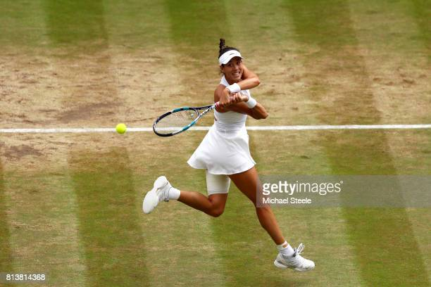 Garbine Muguruza of Spain plays a backhand during the Ladies Singles semi final match against Magdalena Rybarikova of Slovakia on day ten of the...